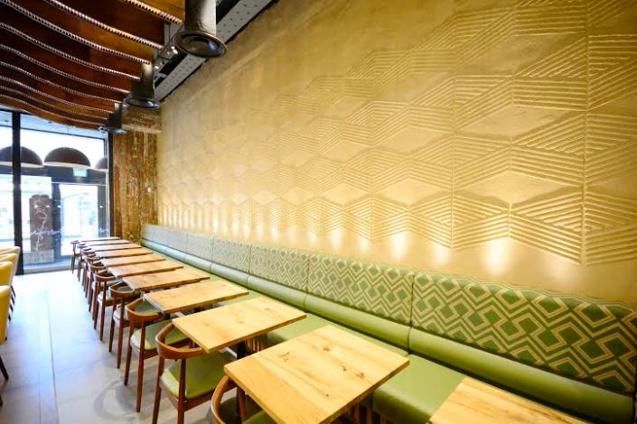 Anaglyptic clay finish, Nando's restaurant in Manchester, photographer Helene Collie van de Langenberg