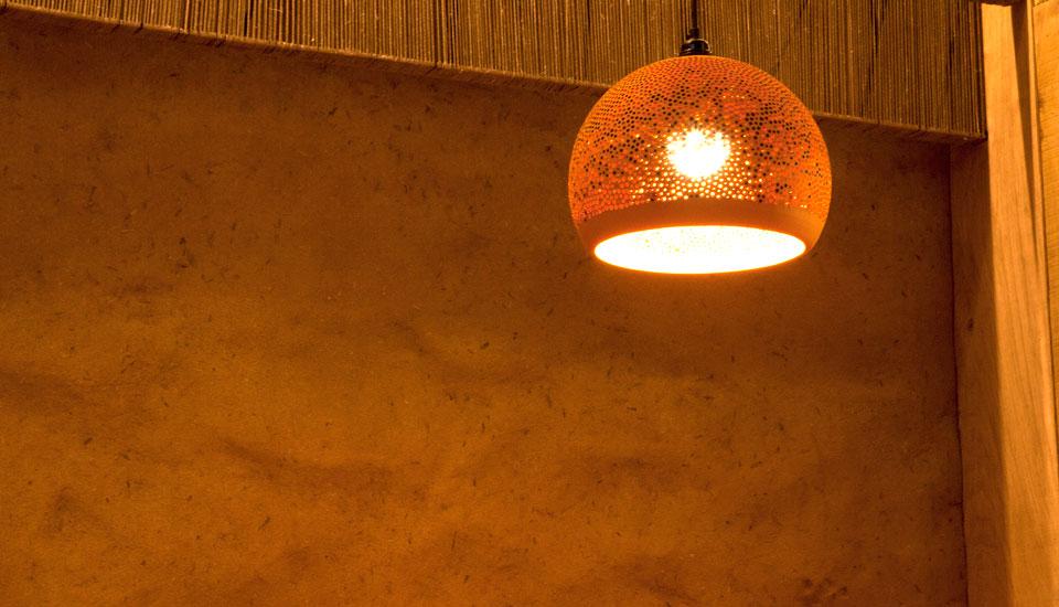 Undulated clay finish, Nando's restaurant in Falkirk, Scotland. Photographer James Parsons
