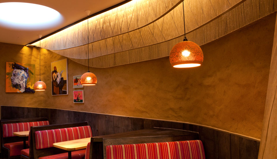 Undulated clay finish. Nando's restaurant in Falkirk, Scotland. Courtesy of Nando's and James Parsons, the photographer