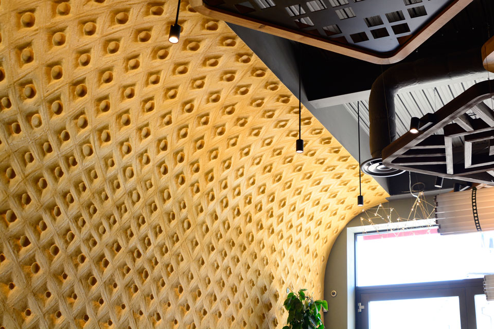 Embossed clay finish, Nando's restaurant in Hereford, photographer James Parsons