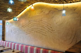 Undulated clay finish, Nando's restaurant in Nottingham Market Square, photographer James Parsons