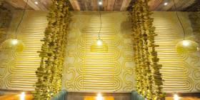 Carved clay finish, Nando's restaurant in Redditch, photographer James Parsons