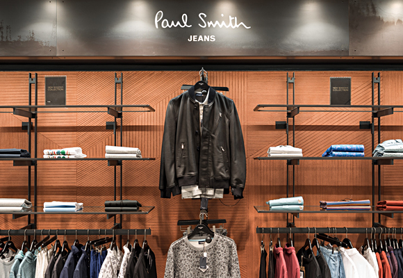 Paul Smith store in Harrods, London. Geometric pattern on smooth clay wall
