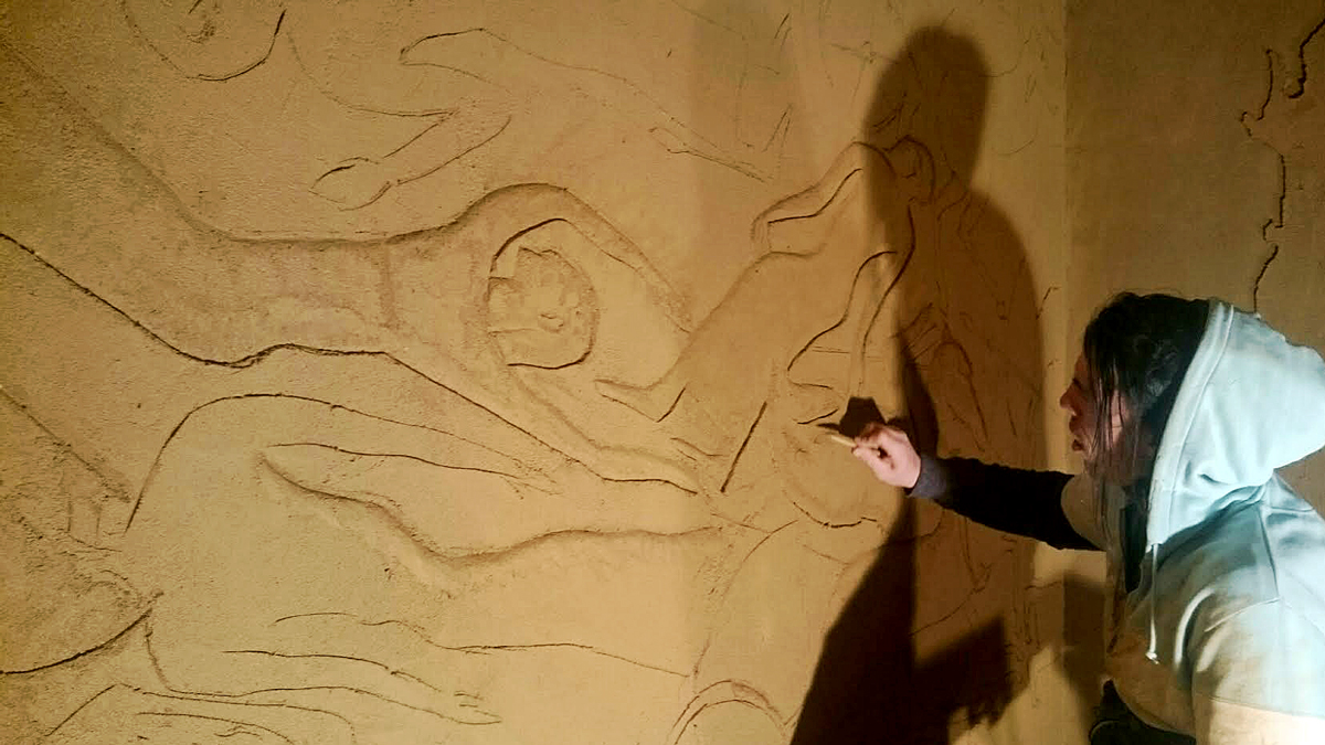Guy Valentine carving clay wall at Hattusa Restaurant in Kent