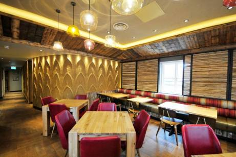 Embossed clay wall, Nando's restaurant in Bicester