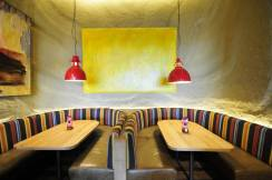 Undulated clay finish, Nando's restaurant in Bristol