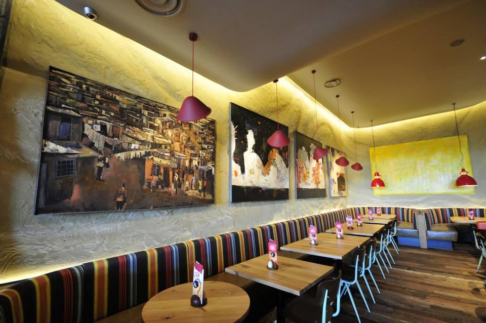 Undulated clay finish, Nando's restaurant in Bristol