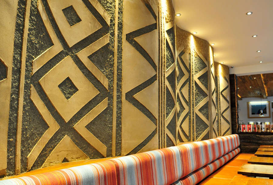 Carved clay wall, geometric pattern, Nando's restaurant in Gloucester