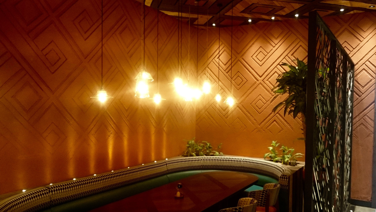 Carved clay wall by Guy Valentine at Nando's restaurant in Dubai.