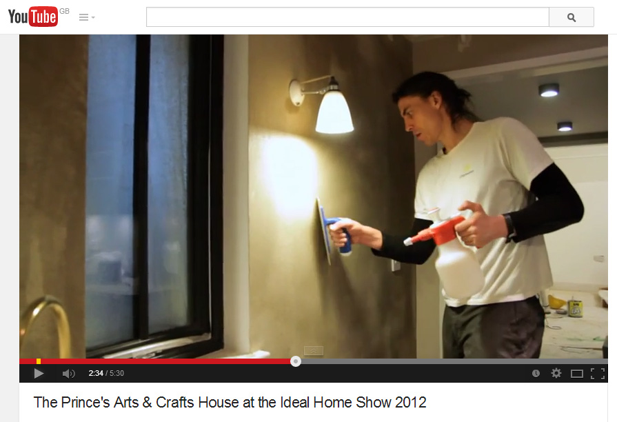 Image of Guy Valentine applying smooth top clay finish at the Prince's Arts and Crafts House, Ideal Home Show in 2012.