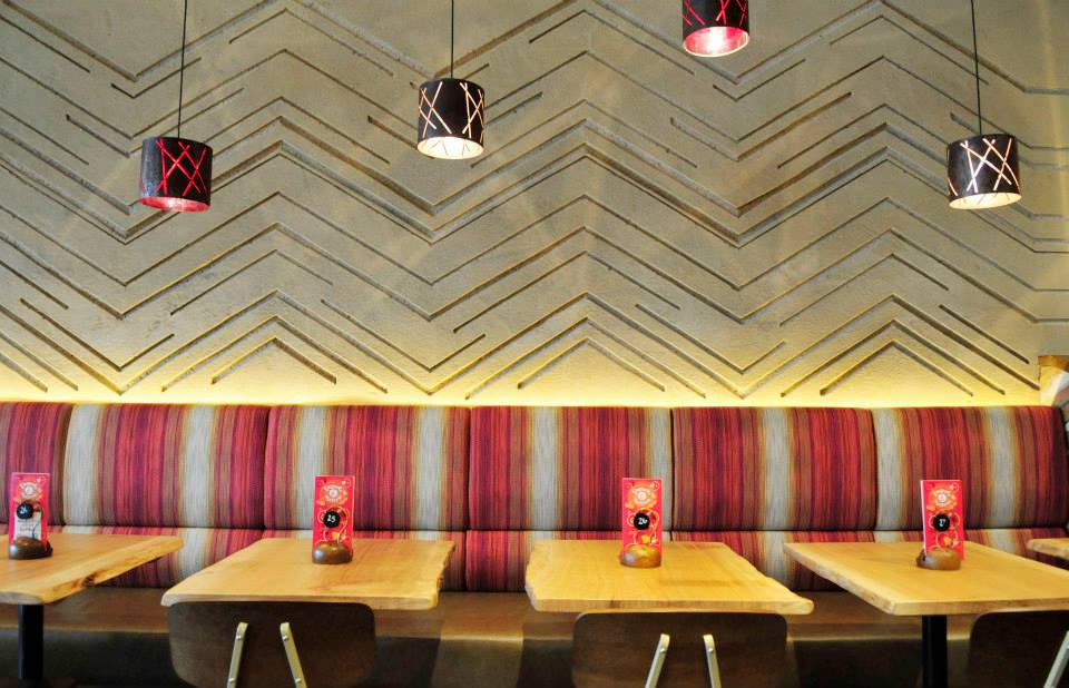 Carved clay wall, multiple colours, geometric pattern, Nando's restaurant in Hamilton