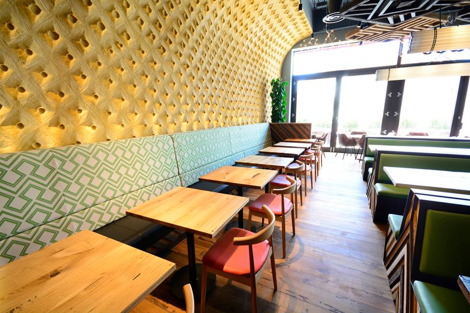 Embossed clay wall, Nando's restaurant in Hereford