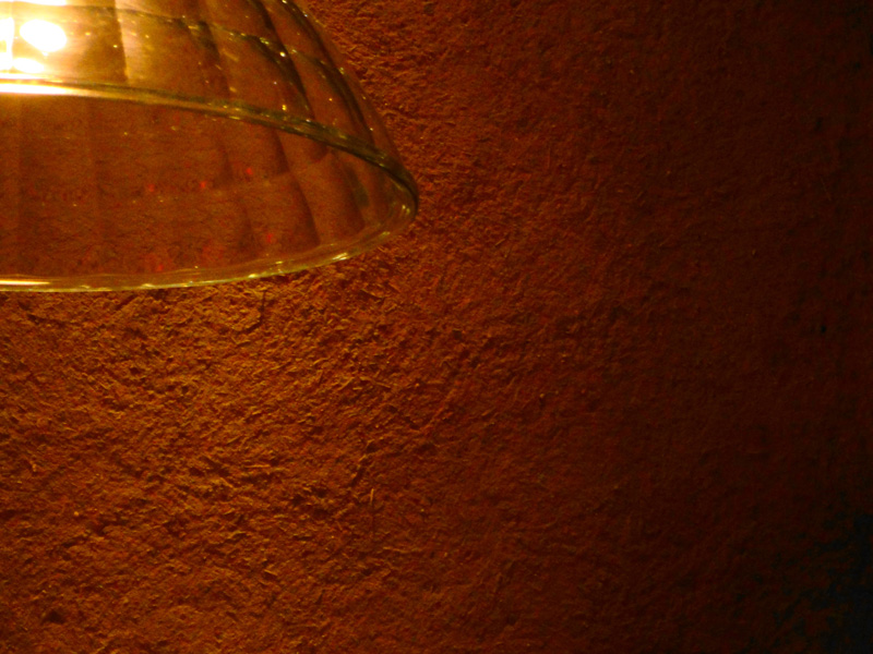 Rough and rustic textured clay finish, Nando's restaurant in High Street Kensington, London