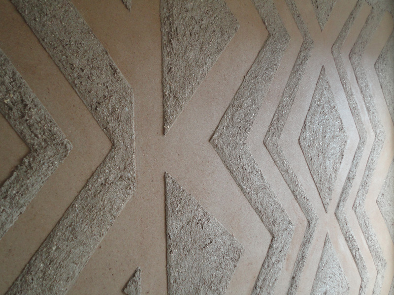 Anaglyptic two tone clay textured wall, Nando's restaurant in Liverpool