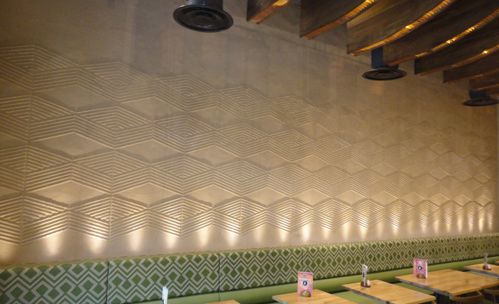 Anaglyptic clay textured wall, Nando's restaurant in Manchester