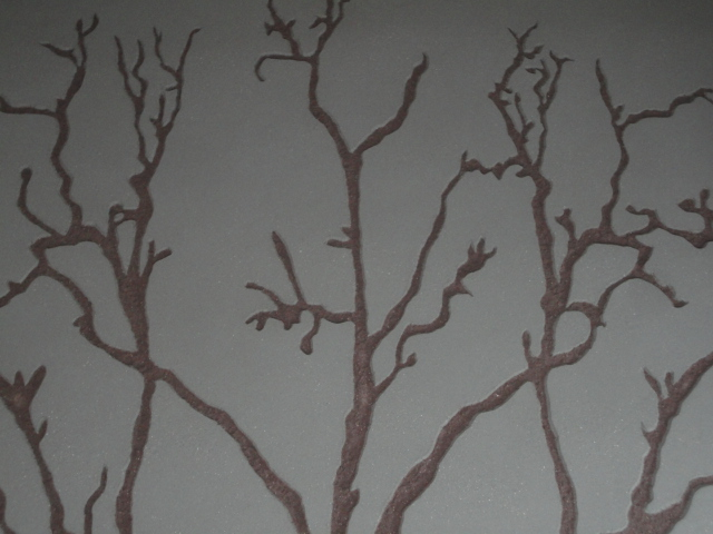 Carved clay wall, tree image, Nando's restaurant in Staines