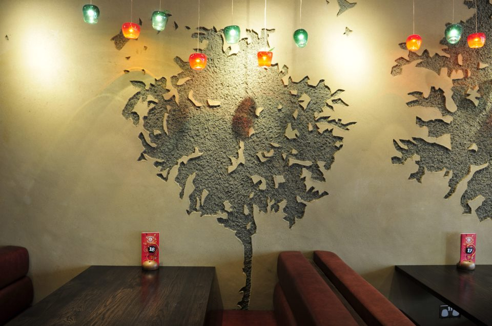 Carved clay tree images, Nando's restaurant in Wales Llanelli