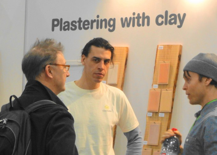 Guy Valentine (middle) and Adam Weismann (Clayworks director, right) discussing clay plastering with a potential client at the Ecobuild