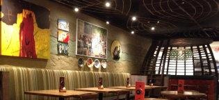 Rammed earth clay finish, Nando's Restaurant in Al Qasba, Dubai, UAE