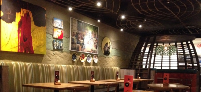 Rammed earth clay finish, Nando's Restaurant in Al Qasba, Dubai, UAE