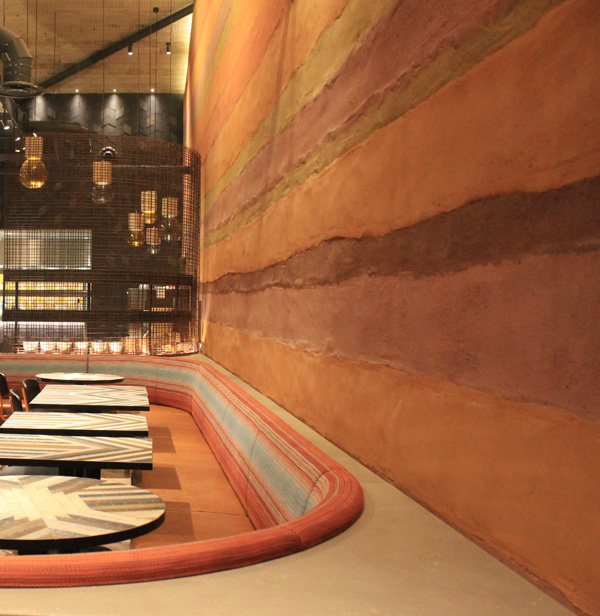 Rammed earth clay finish, Nando's restaurant in Chesterfield